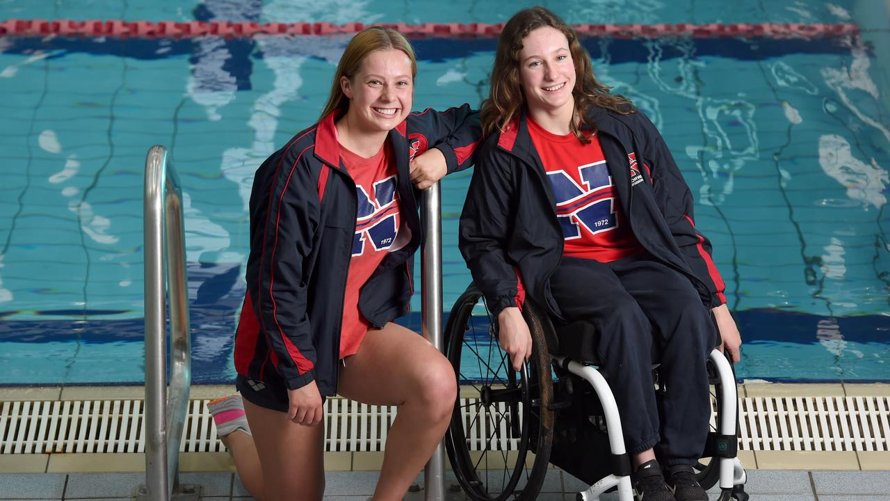 Norwood Swimming Club members Izzy Vincent (R) with (para swimmer) and Emily White ahead of last year's SA Short Course Swimming Championships. Picture: Naomi Jellicoe
