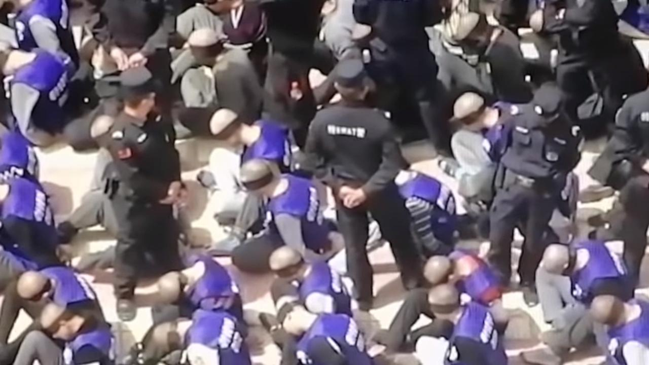 Drone footage shows blindfolded and shackled Uighurs in Xinjiang. Picture: YouTube