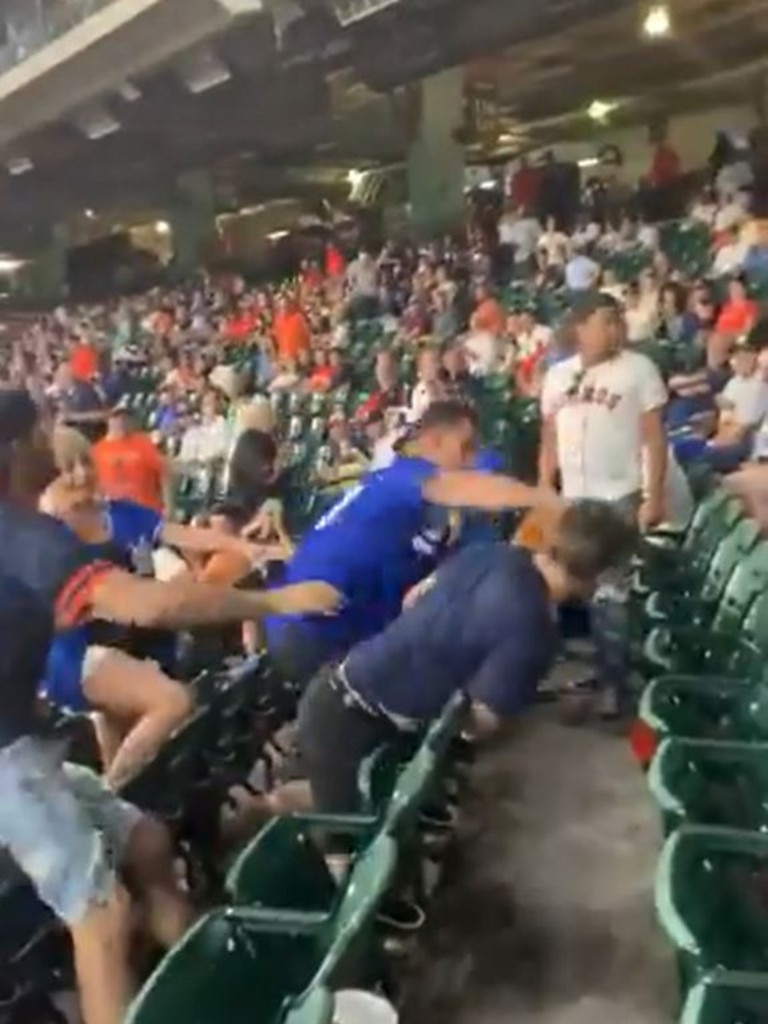 The Dodgers fans landed repeated right hands to another man's head.