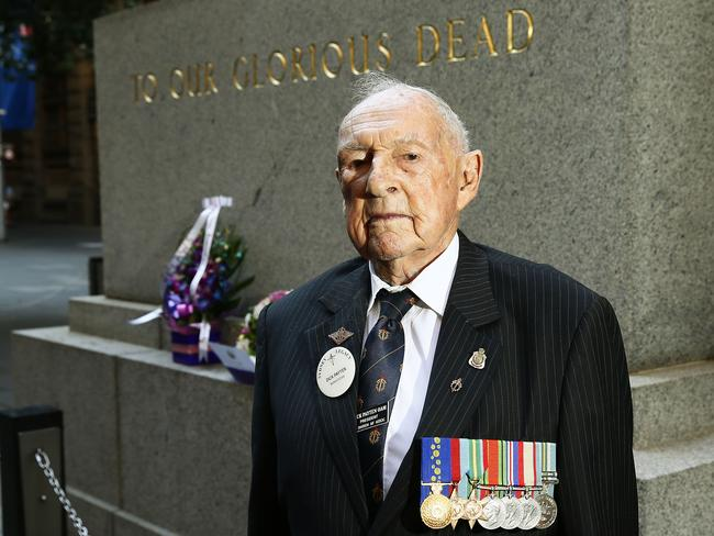 95-year-old WWII veteran Dick Payten in front of the Martin Place Cenotaph. Picture: John Appleyard