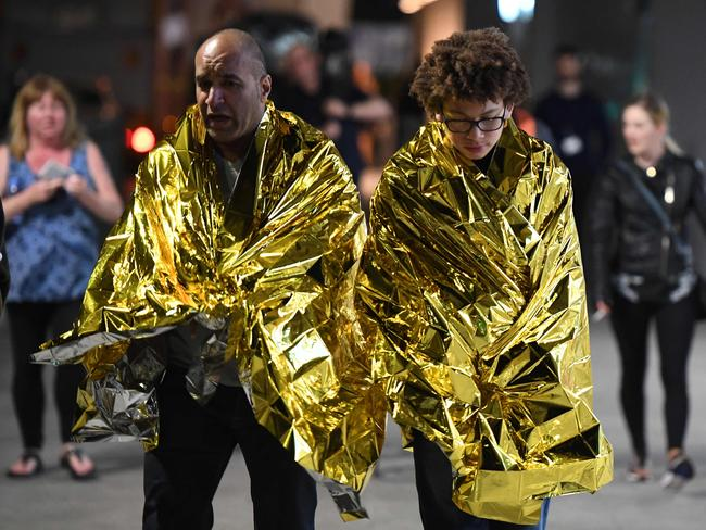 Members of the public, wrapped in emergency blankets leave the scene of a terror attack on London Bridge in central London. Picture: AFP