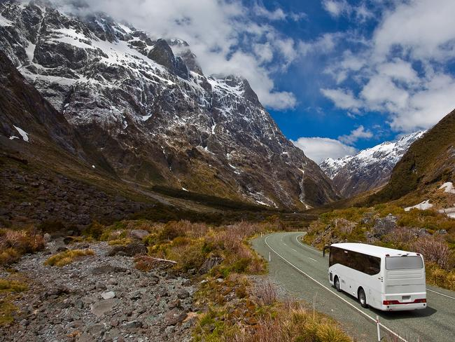 A tourist bus in New Zealand on its way from Milford Sound to Te Anau.