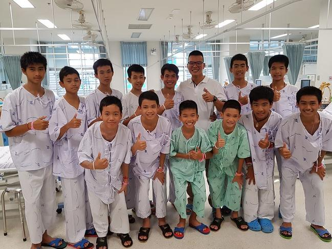 Dr Pak Loharachun, wearing glasses, with the Wild Boars soccer team in hospital. <br/>Picture: Facebook