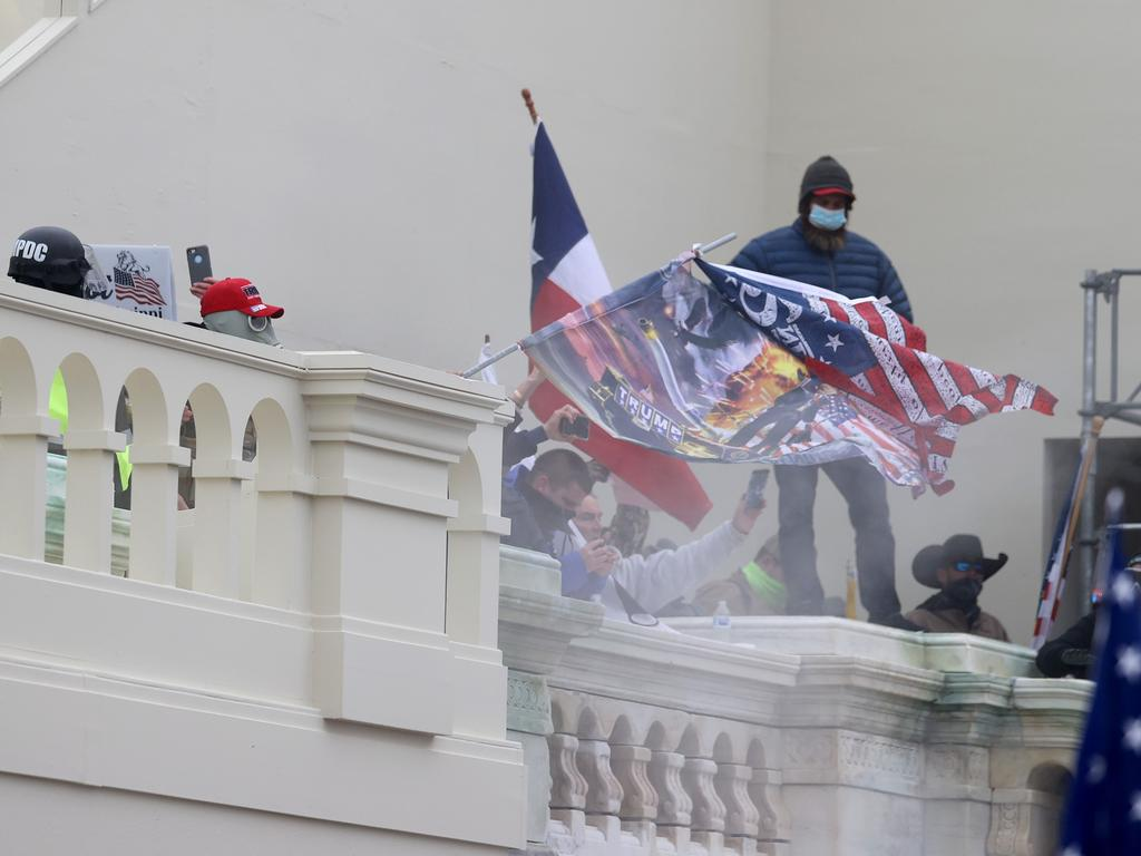 Protesters gather on the balconies of the US Capitol Building. Picture: Tasos Katopodis/Getty Images/AFP