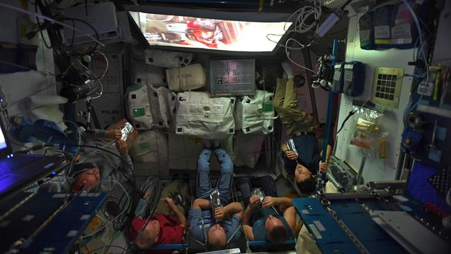 Astronauts watch a movie while on the ISS