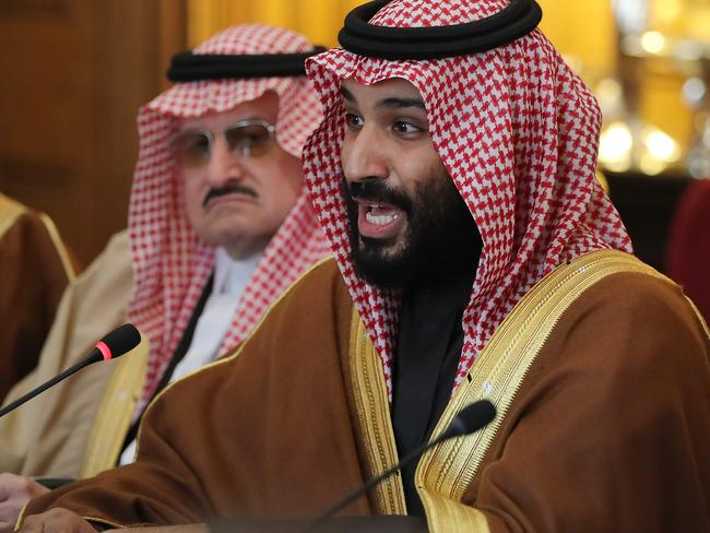 """Saudi Arabia's Crown Prince Mohammed bin Salman (R) gestures during a meeting with Britain's Prime Minister Theresa May (unseen) and other members of the British government and Saudi ministers and delegates at number 10 Downing Street, in central London, on March 7, 2018.  British Prime Minister Theresa May will """"raise deep concerns at the humanitarian situation"""" in war-torn Yemen with Saudi Crown Prince Mohammed bin Salman during his visit to Britain beginning Wednesday, according to her spokesman. / AFP PHOTO / POOL / Dan Kitwood"""