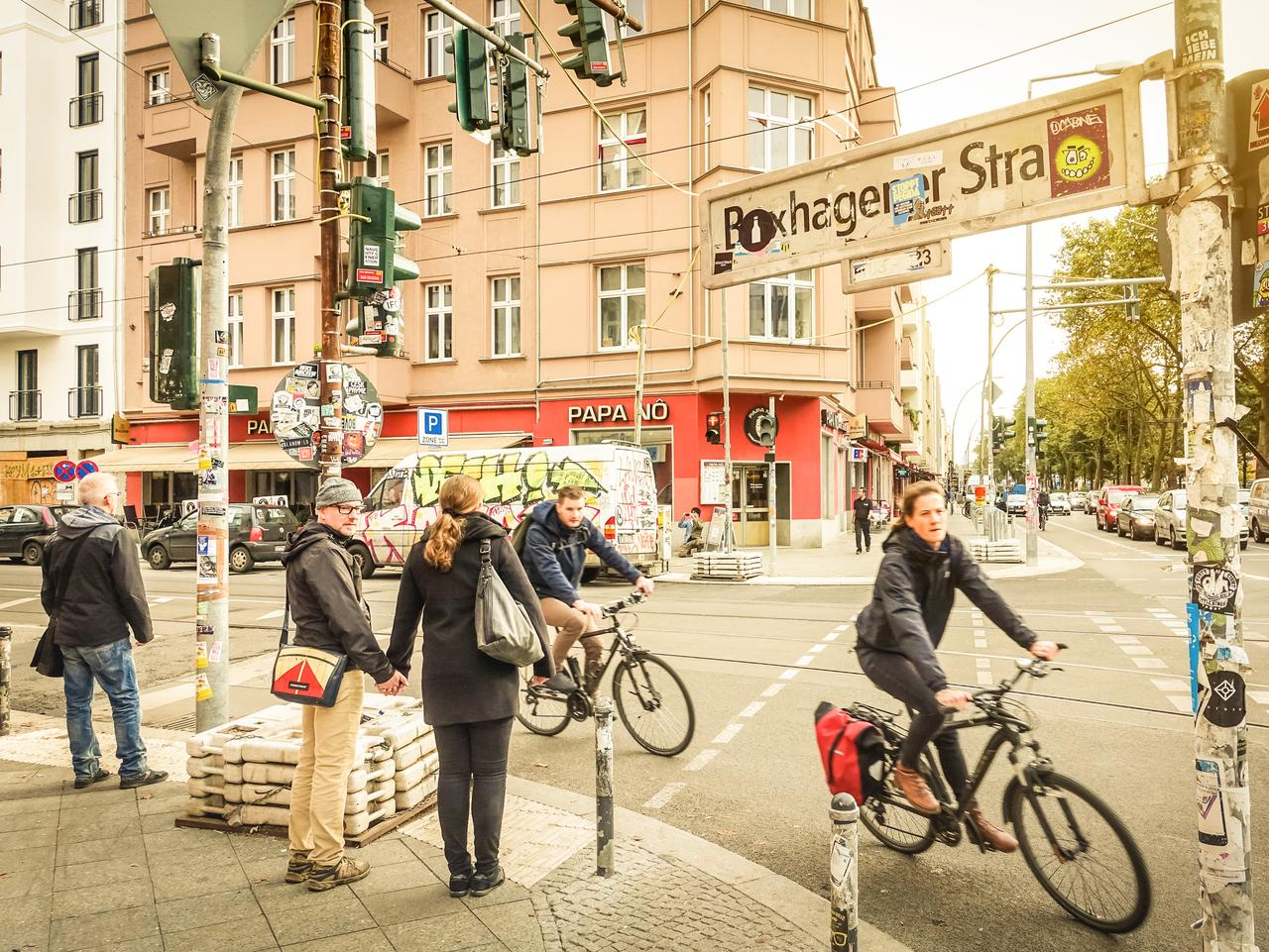 Berlin, Germany - October 7, 2016: motion view of everyday life with bikers and pedestrians at beginning of Box Hagener Strasse in the area of Friedrichshain in a standard grey autumn day