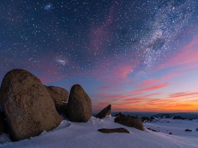 KOSCIUSZKO NATIONAL PARKThis otherworldly scene of snow, stars and sunshine was captured in Kosciuszko National Park in the Snowy Mountains at sunset. While the Snowy Mountains are known as NSW's winter playground, the natural wonders abound in any season. Picture: Ben CoopeSee more: BEST THINGS TO DO IN SNOWY MOUNTAINS IN THE SUMMER