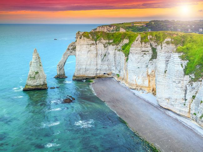 SEE THE BREATHTAKING CLIFFS AT ÉTRETAT One of the most awe-inspiring natural sights in France is of the white chalk cliffs at Etretat. A favourite with the Impressionist painters back in the 19th century, the natural rock arches here are incredibly beautiful, especially when enjoyed from the beach below, where locals love to gather during the summer months. Picture: B. Collier / Normandie Tourisme