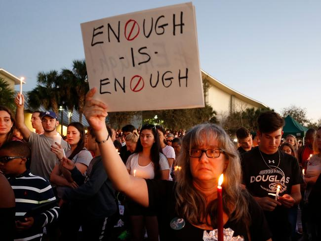 Mourners during a candlelight vigil for the victims of the mass shooting. Picture: AFP