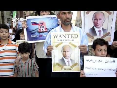 SYRIA: Syrians Hold Wanted Posters for Putin as They Mark a Year of Russian Strikes September 30
