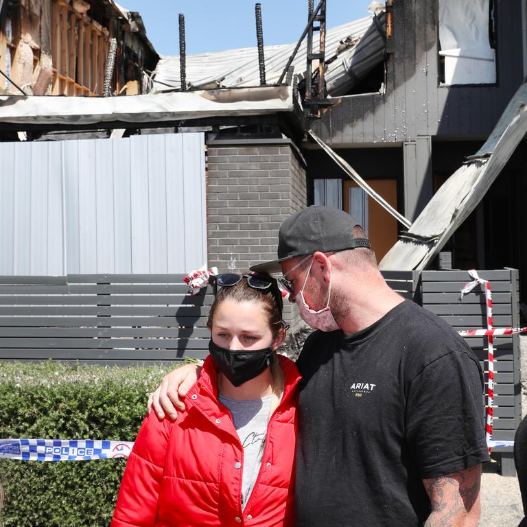 Emily Forrest and her partner Joel Martin outside her sister Abbey's destroyed townhouse. Picture: NCA NewsWire/ David Crosling