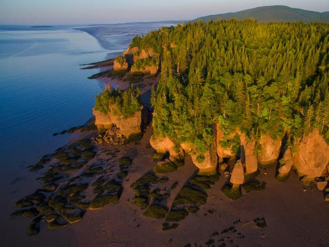 HOPEWELL ROCKS, NEW BRUNSWICK Time and tide have carved the majestic Hopewell Rocks into these bizarre sandstone formations, topped with trees. No wonder they're also known as Flowerpot Rocks. Situated on the upper reaches of the Bay of Fundy, famous for its extreme tidal range, you can walk around these unique formations at low tide.
