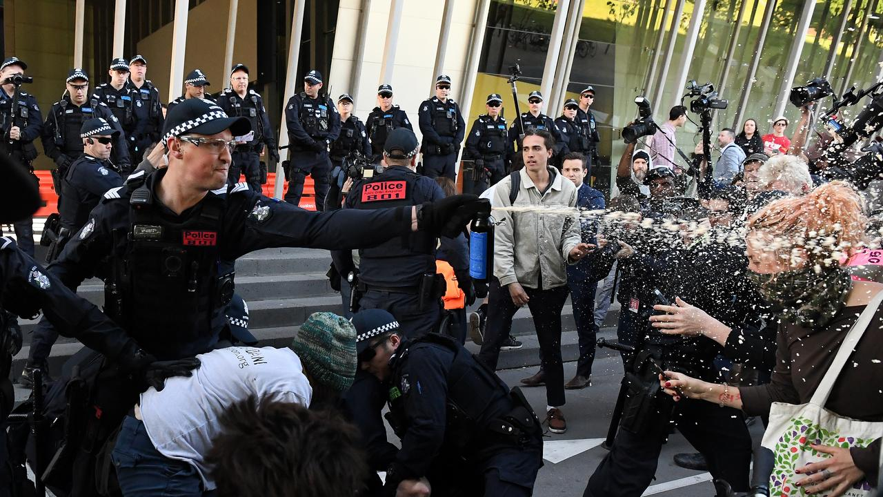 Victoria Police deploy OC spray on protesters on Tuesday. Picture: James Ross/AAP