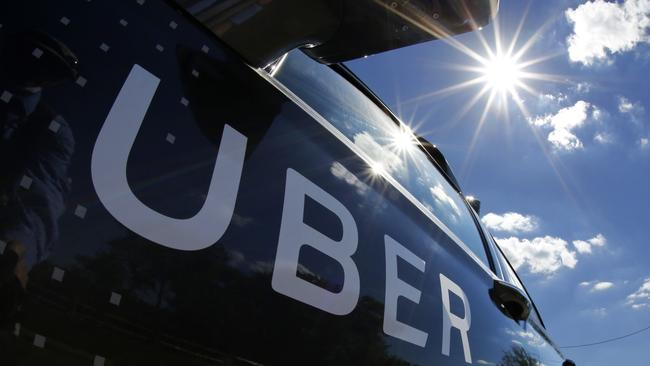 A SYDNEY Uber driver has been charged over the death of a passenger who fell in front of a bus and died. Picture: Gene J. Puskar/AP
