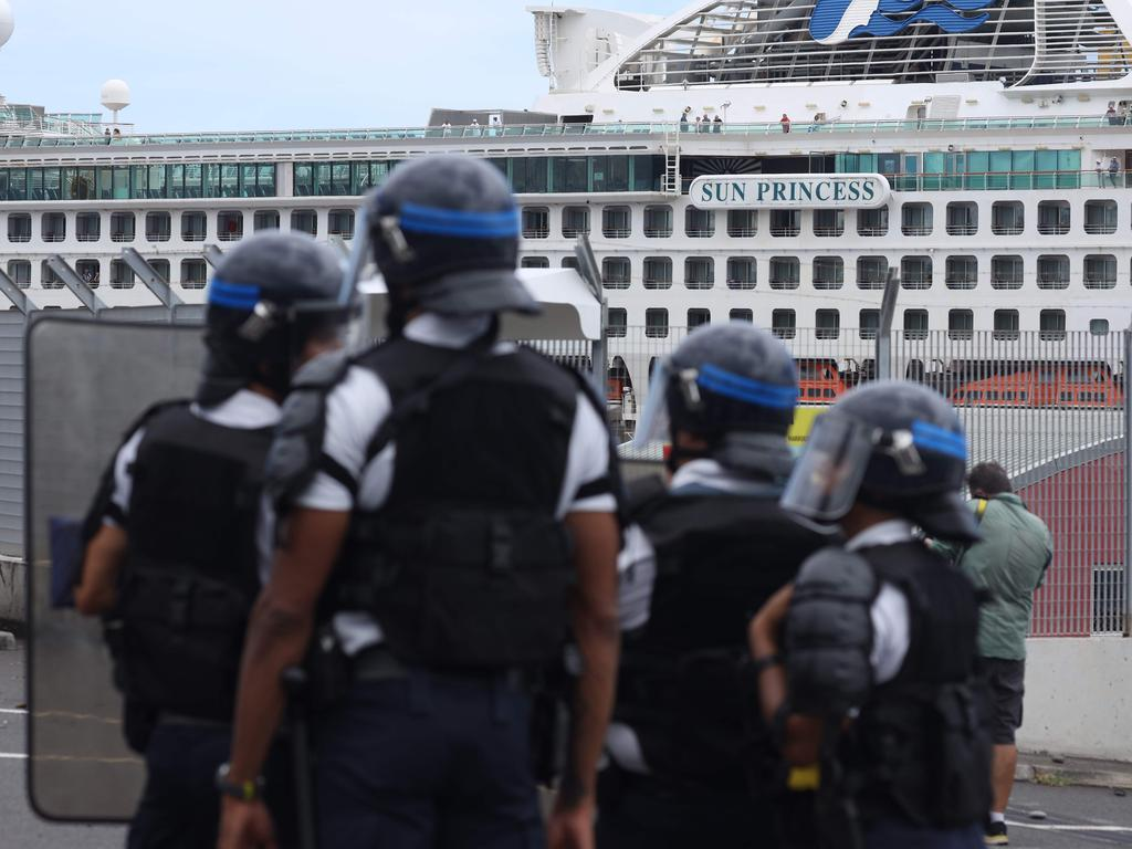 French police officers face demonstrators protesting against the arrival of the Sun Princess. Picture: Richard Bouhet/AFP
