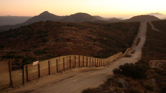 The US-Mexico border fence, near the rural town of Campo, some 60 miles east of San Diego, California, in 2009.