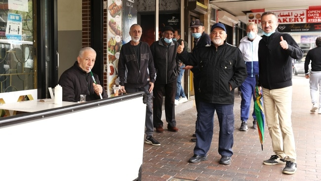 Patrons of a cafe pose as they meet outside on the sidewalk in Fairfield on Monday. Picture: Mark Kolbe/Getty Images