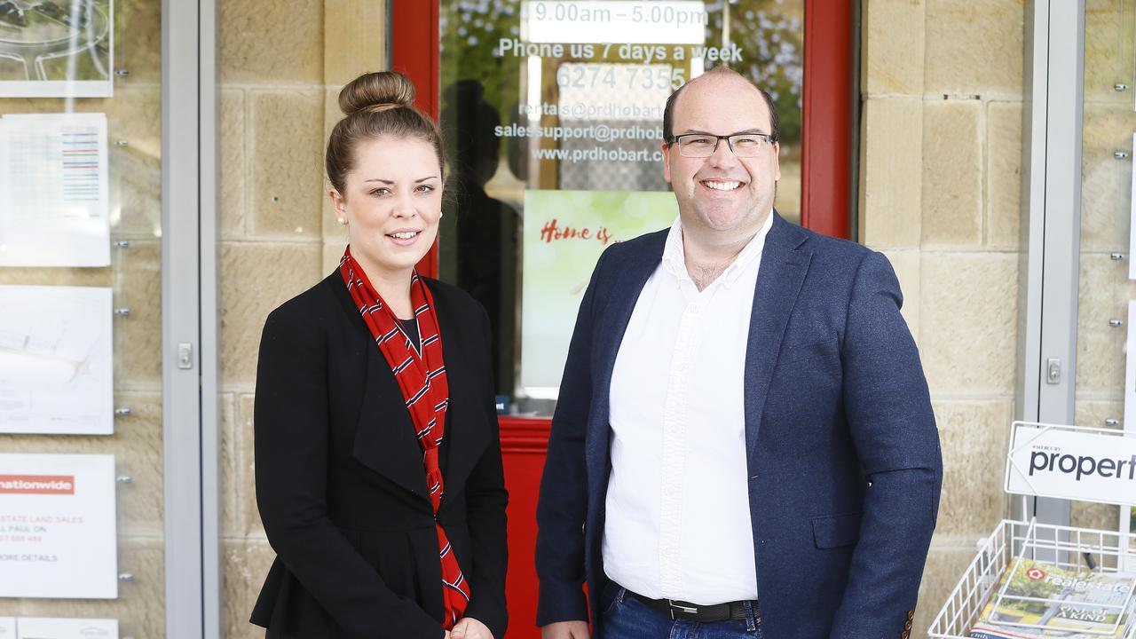 Rychelle Kay, real estate agent and Paul Reed, sales consultant and are pictured at their PRD office in Glenorchy. Picture: MATT THOMPSON
