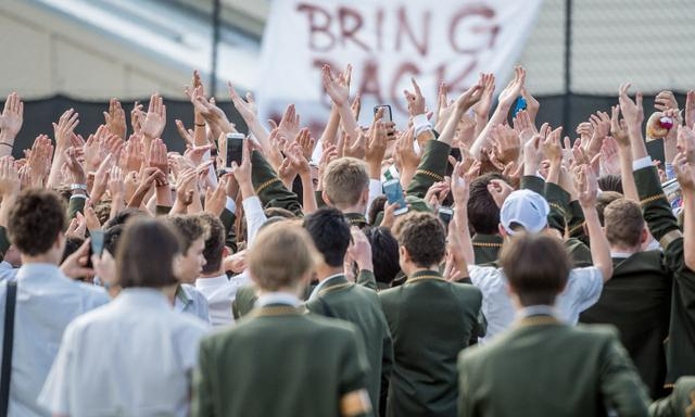 Trinity Grammar students protest over the sacking of of dep. headmaster Rohan Brown. Students protest the sacking of their Dep. Headmaster Rohan Brown on the school oval during morning break. Picture: Jake Nowakowski