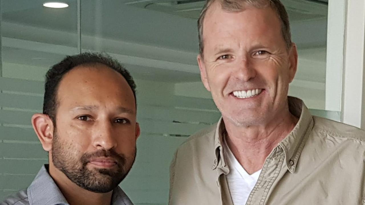 """Neil McLean, pictured with Dr Motiwala, now has a """"Tom Cruise killer smile"""". Picture: Facebook"""