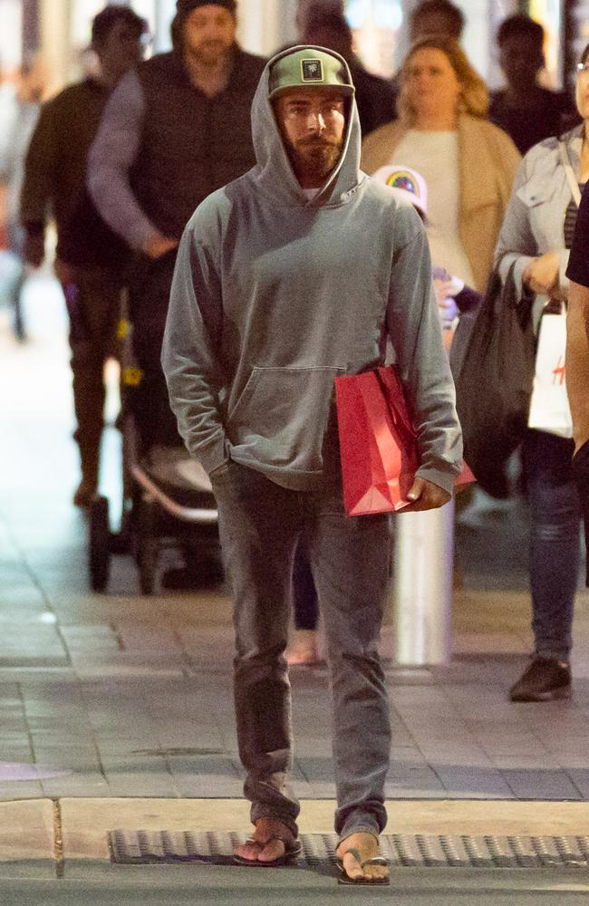 Zac Efron almost went unnoticed on a busy Friday night shopping in Adelaide's Rundle Mall. Picture: Media-mode.com