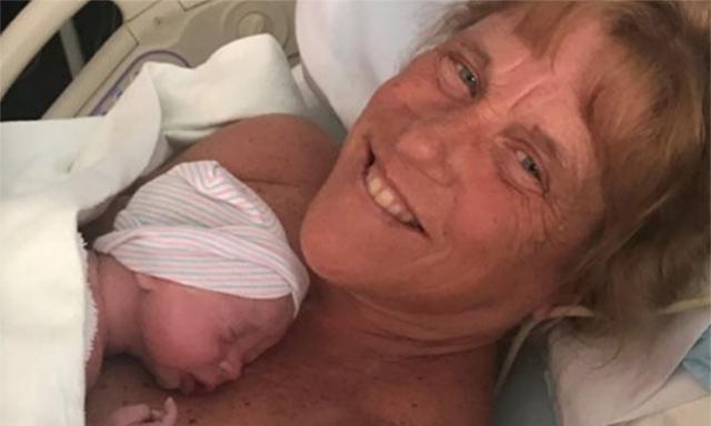 57yo mum gives birth