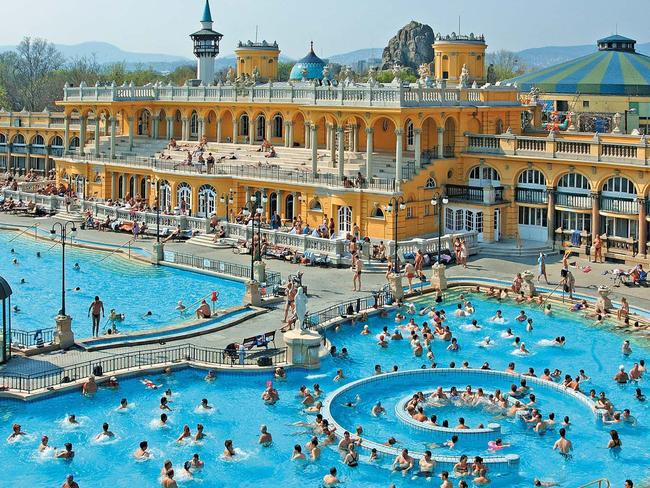 SZECHENYI THERMAL BATH BUDAPEST, HUNGARY: A hangover from the ancient Roman settlers who first brought the idea of hydrotherapy to the country, public bathing for health benefits has been a staple in Budapest for centuries. Using natural hot springs, the Szechenyi Thermal Bath was built in 1913 and is now the most visited attraction in the city. Comprising three outdoor pools, inside the neo-baroque palace there's an extra 18 thermal spring-fed pools, plus 10 saunas and steam rooms, as well as spa services. szechenyispabaths.com