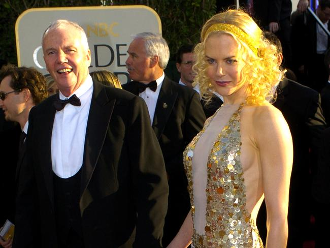 Proud dad ... Nicole Kidman is escorted by her father for the 2004 Golden Globes. Picture: AP