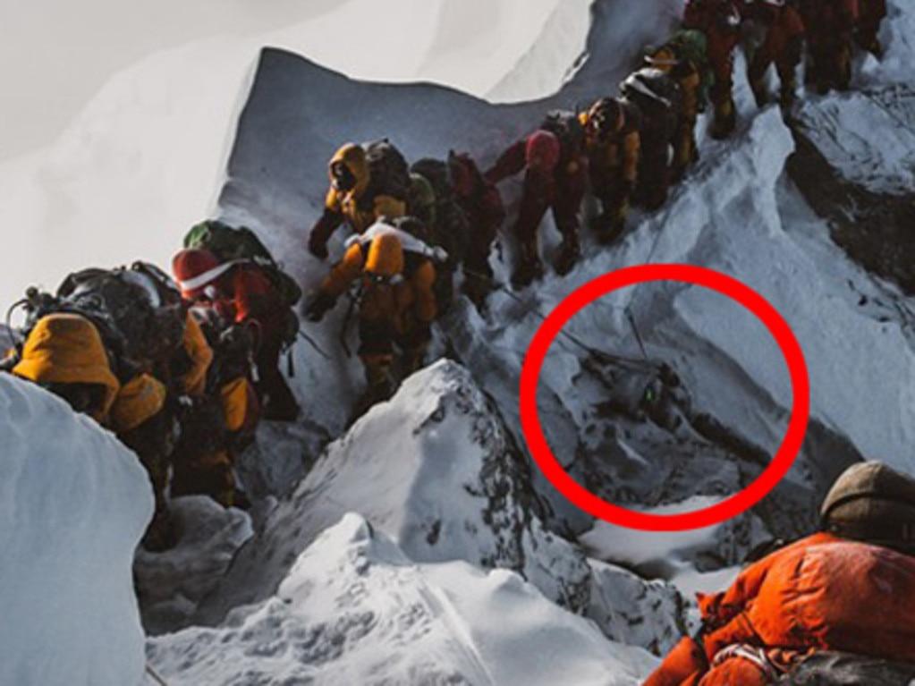 Elia Saikaly's disturbing photograph shows tourist climbing over a dead body to continue their journey.