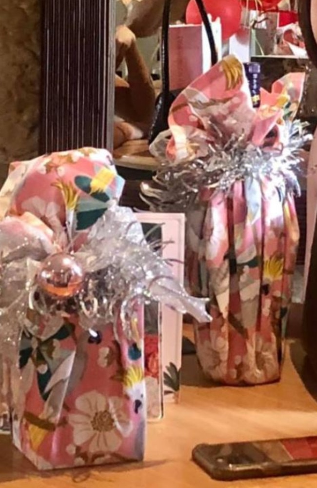 A Sydney mum has shared a photo showing how she used a tea towel from Kmart to wrap her Christmas gifts. Picture: Facebook/ KmartHomeDecor&HacksAustralia