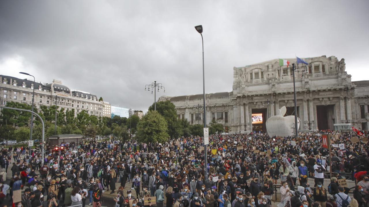 Protesters gather in Milan. Picture: Luca Bruno/AP