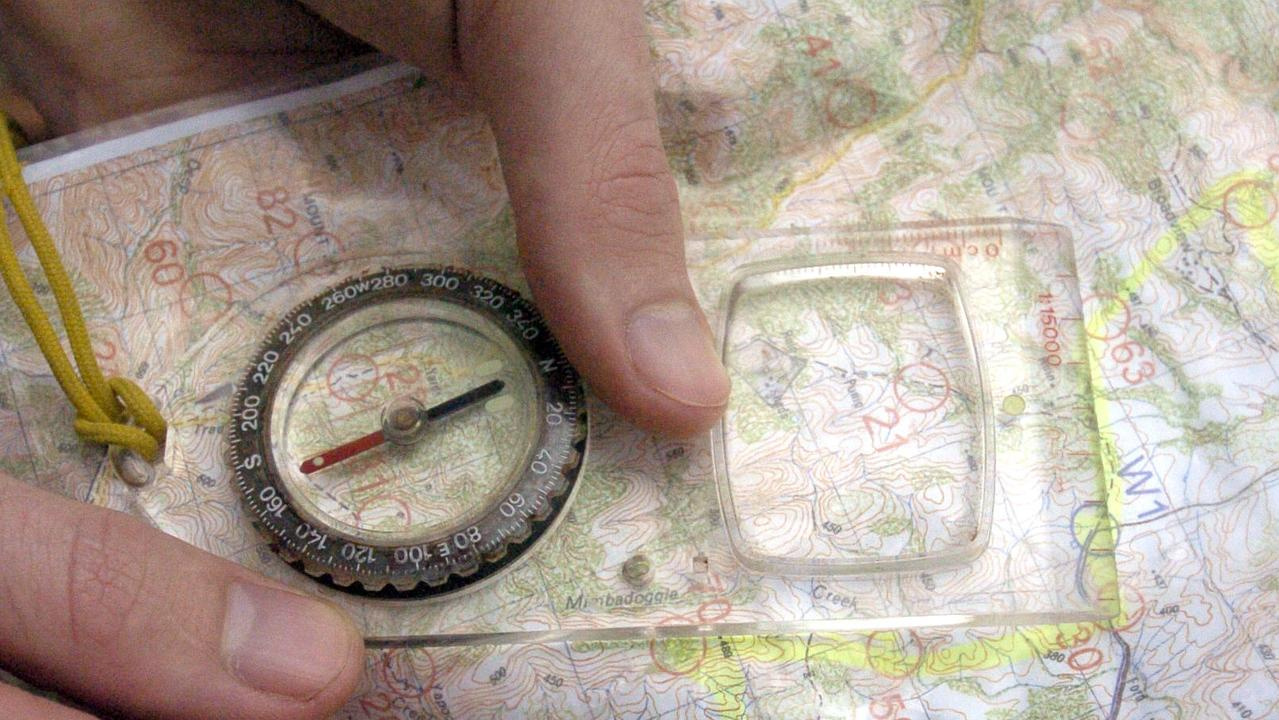 Compass and map used for orienteering 16 Jun 2004.  navigation skills maps  mapping activities