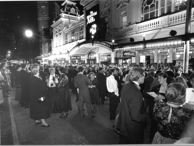 Theatre goers gather out on Spring St during the premiere of Phantom of the Opera.