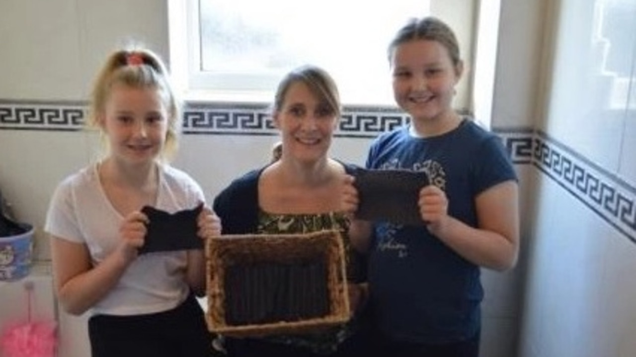 Kelsey poses with her girls and her homemade loo roll. Picture: Lily Canter/Collect