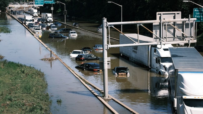Hurricane Ida caused chaos in the northeast of the United States as record rain fell in parts of New York, forcing people to abandon their cars on the highway as flood water rose. Picture: Spencer Platt/Getty Images