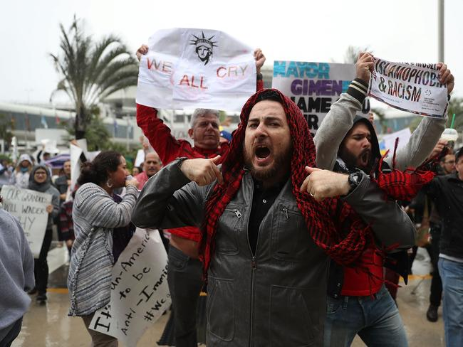 Protesters stand together at the Miami International Airport against the executive order that President Donald Trump signed clamping down on refugee admissions. Picture: Getty