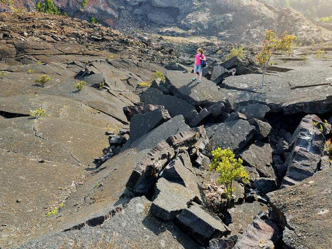 68. FEEL THE HEAT AT HAWAII'S VOLCANO NATIONAL PARK Hike across Hawaii's lava fields, feeling the heat rise from the cracks as you pass by erupting craters. Go underground to explore flowing lava tubes or venture up the active volcano of Kilauea to witness its mighty rumble.