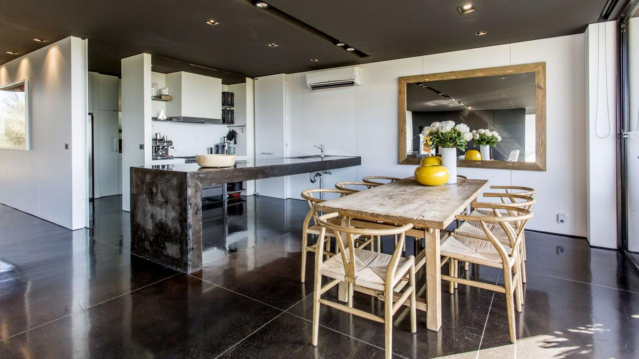 The kitchen's handcrafted concrete island bench adds to its edgy appeal.