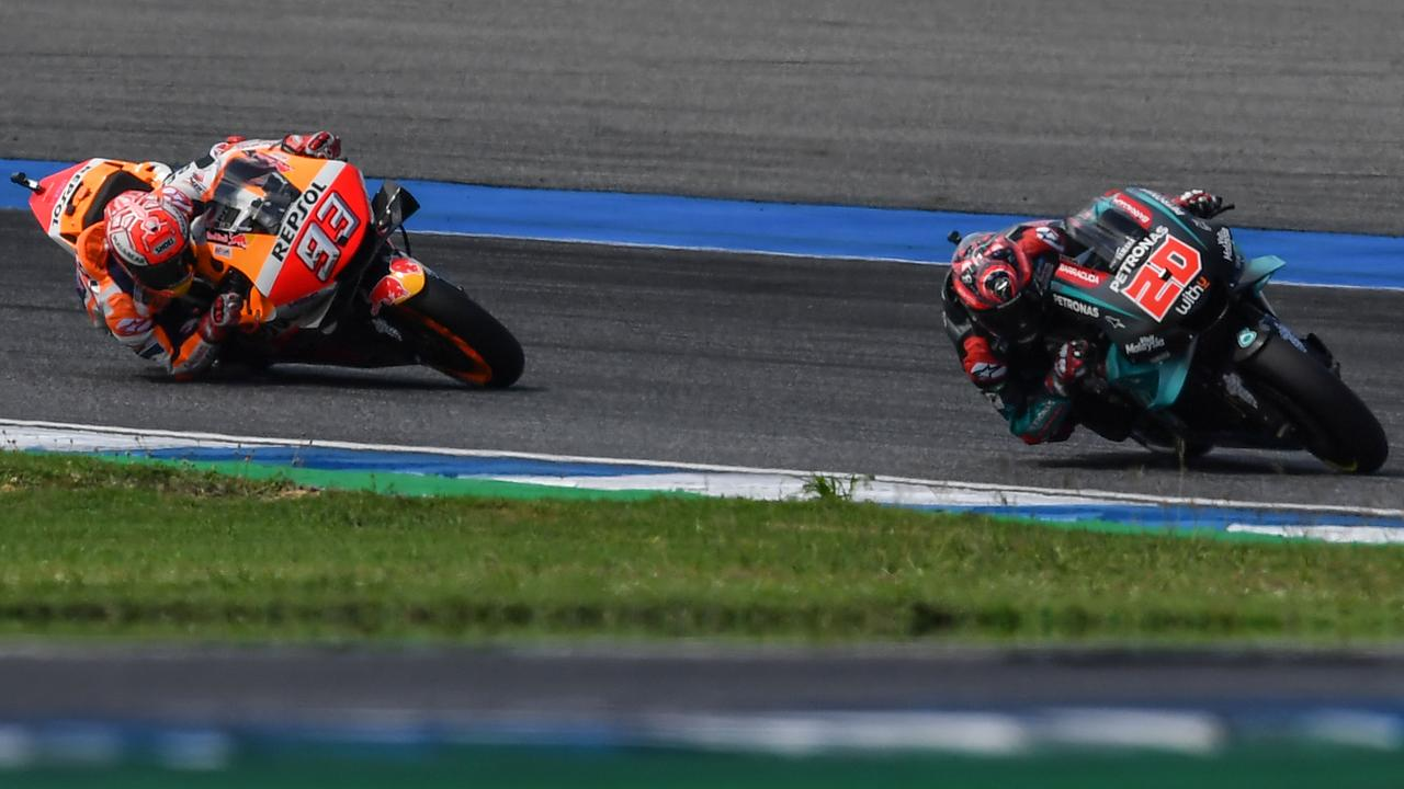 Fabio Quartararo (R) is hounded by Marc Marquez in the race. Picture: Lillian Suwanrumpha