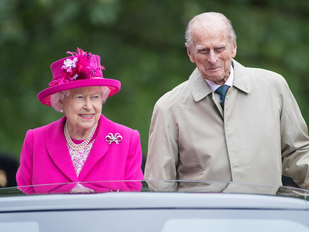 Queen Elizabeth reportedly walked her new puppies on her first weekend without husband Philip.