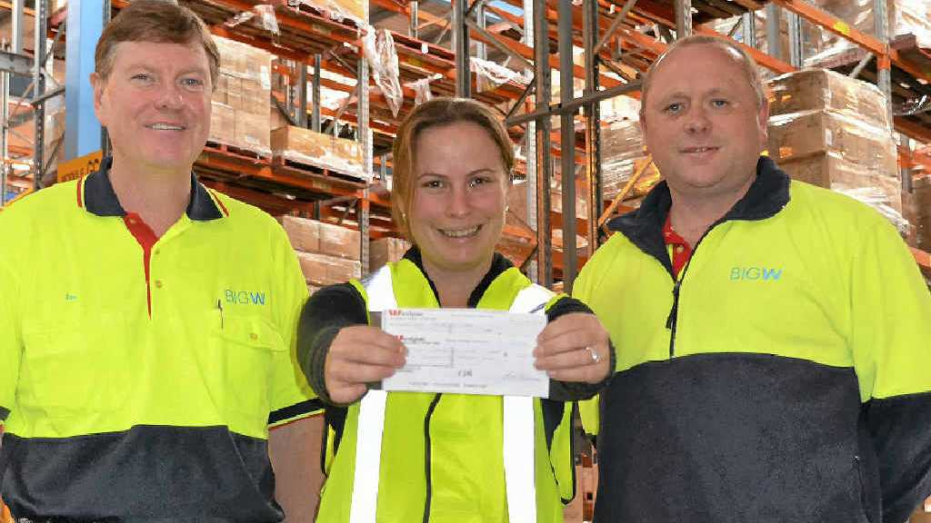 Big W DC HR manager Ian Jamieson and acting DC manager Scott Grady hand over a cheque to CareFlight's Suzie Washington, one of the many charities they support.