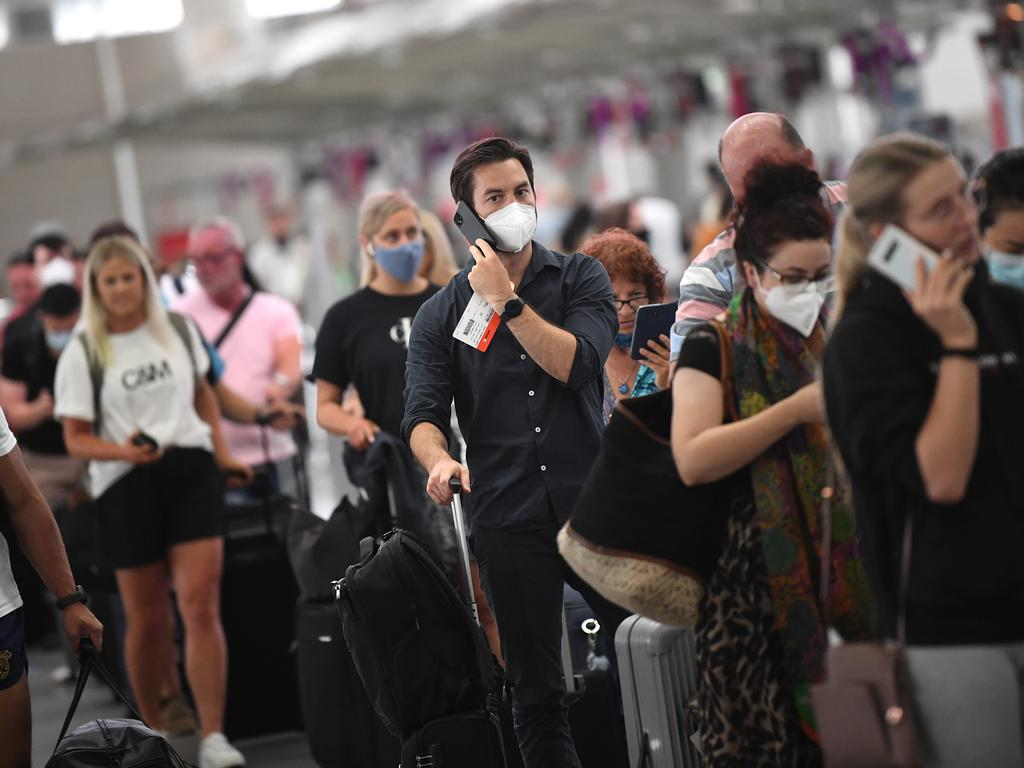 Sydney Airport is packed as people rush to leave the state. NCA NewsWire/Joel Carrett