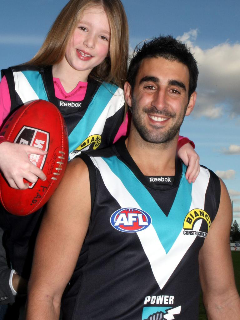 Port Adelaide Power captain footballer Dom Cassisi wearing the jumper designed by 7 yo. Lucy Burford the team will wear this weekend.