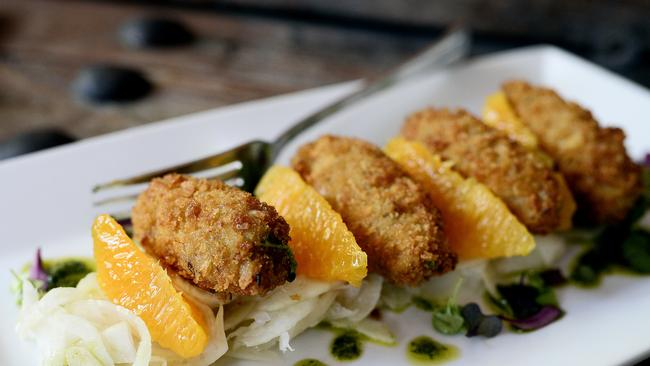 Confit duck croquettes with salsa verde, pickled fennel, orange and coriander. Picture: Richard Hatherly