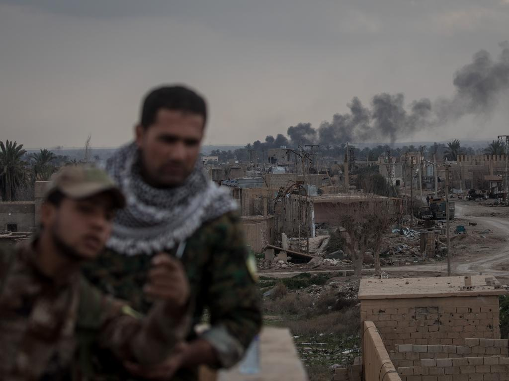 """US-backed forces were locked in fierce fighting on Sunday as they pressed the battle against the last shred of the Islamic State group's """"caliphate"""" in eastern Syria. Picture: Chris McGrath/Getty Images"""