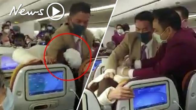 WATCH: Chinese passenger tackled on flight after sparking coronavirus panic
