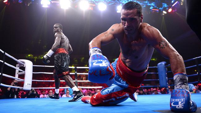Anthony Mundine hits the canvas against Joshua Clottey in Newcastle. Picture: Peter Lorimer