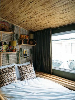 The Jungle Room has faux plants and bamboo furniture. Picture: Airbnb
