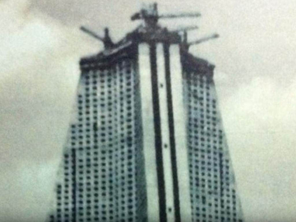 Construction with cranes atop the building in the 20th century.
